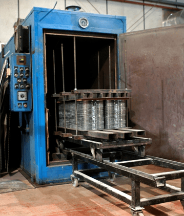 Oven curing of heat exchanger gaskets