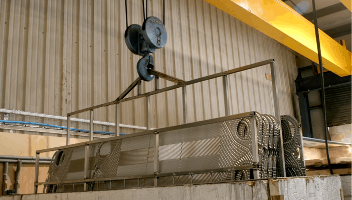 Heat exchanger - removal of deposits using a non-abrasive chemical clean